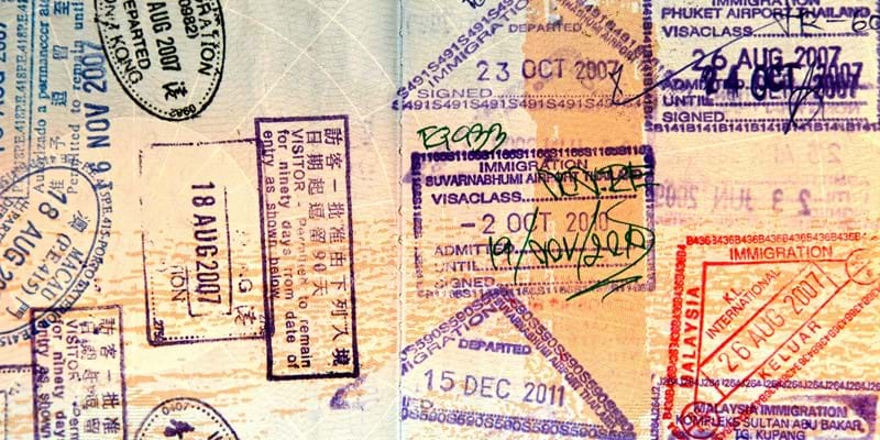 Detail view of passport with multiple stamps